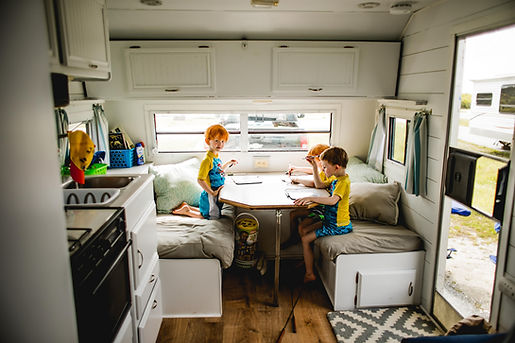 boys playing card game in vintage trailer at Eastern Shore Maryland