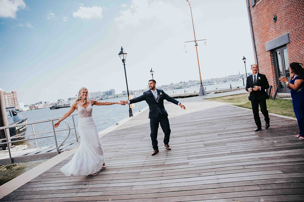 bride and groom on dock in Baltimore Maryland for wedding