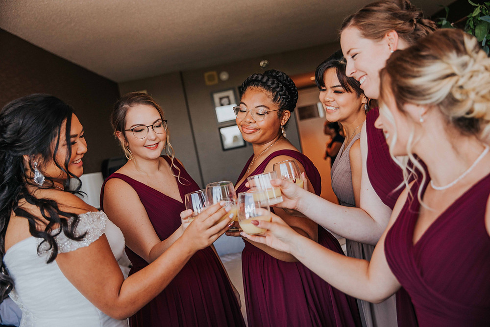 Bridal Party cheers with wine glasses