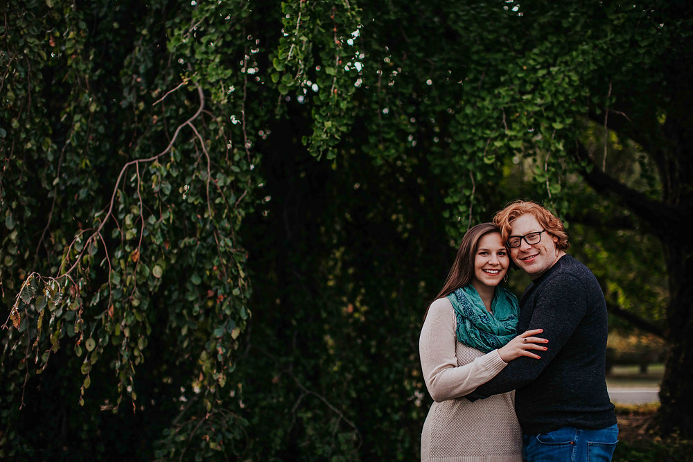Vibrant green backdrop of couple in Baltimore Maryland