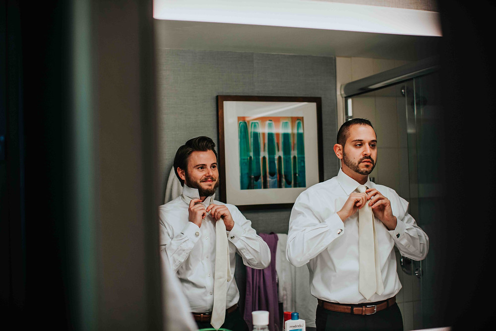 Groomsmen getting ready at hotel in Baltimore Maryland