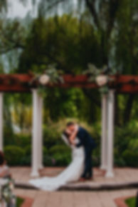 bride and groom kissing at turf valley golf course in maryland