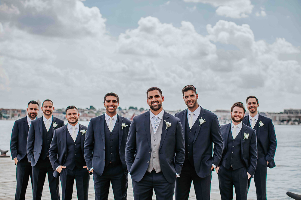 groomsmen laughing with each other at Frederick Douglass maritime museum