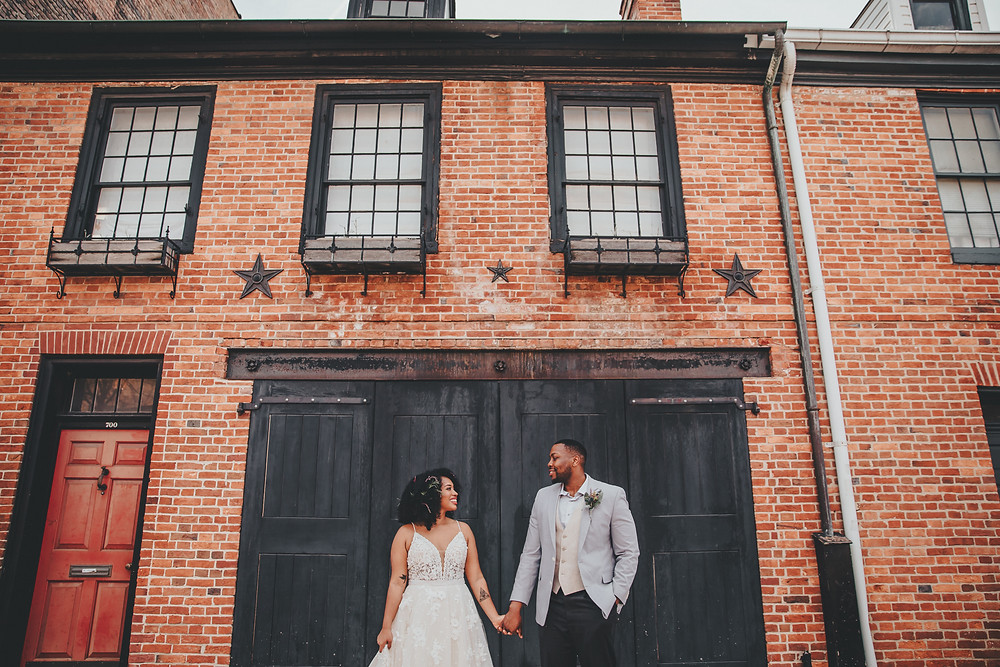 Couple posing in Fells Point Baltimore in Wedding Attire