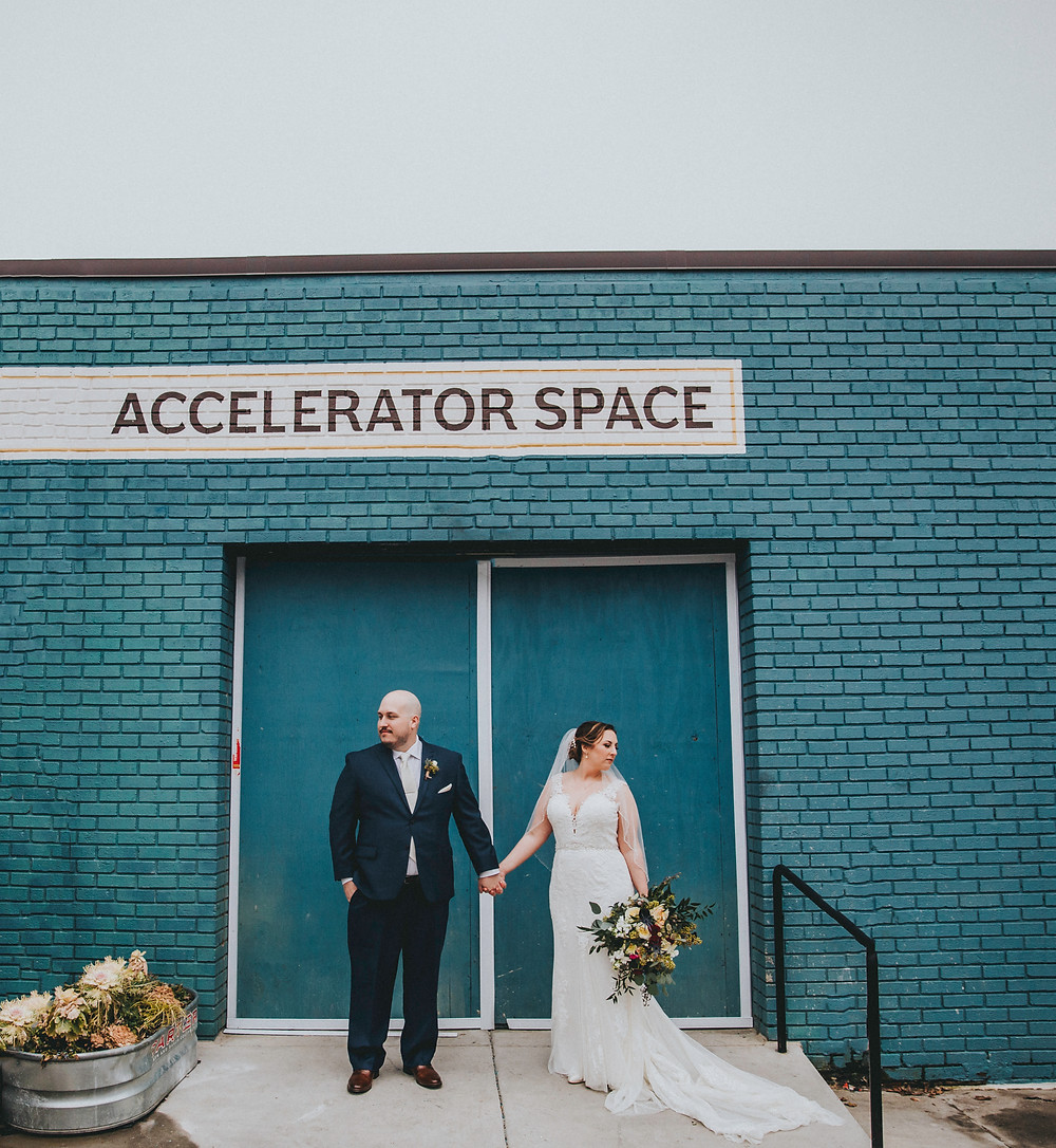 Bride and Groom holding hands at Accelerator Space Baltimore