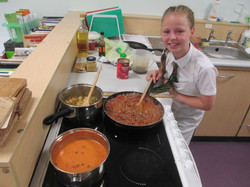 Elise McCarthy  of Shakespeare School cooking her Spag Bol Soup and Veg web