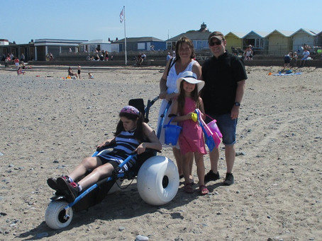 Sunshine and smiles as we get wheels on the beach!