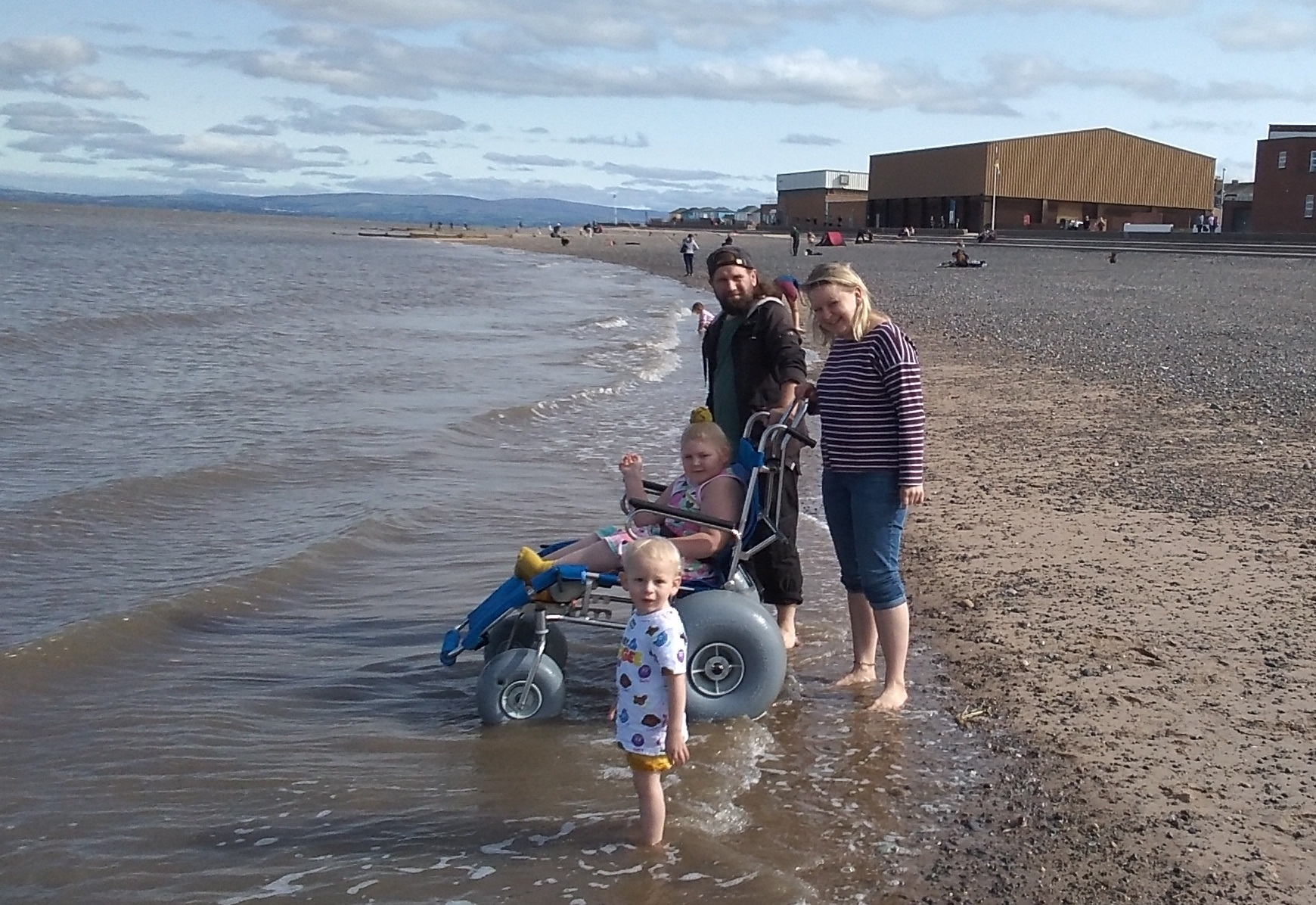 Indi and family getting their feet and wheels wet!