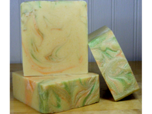 Three white with green and orange swirls bars of soap