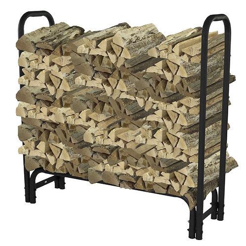 Black metal stand holding wood logs