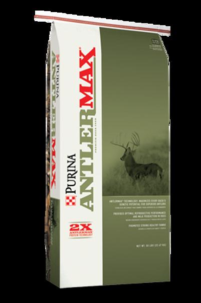 Green and white bag Purina deer feed