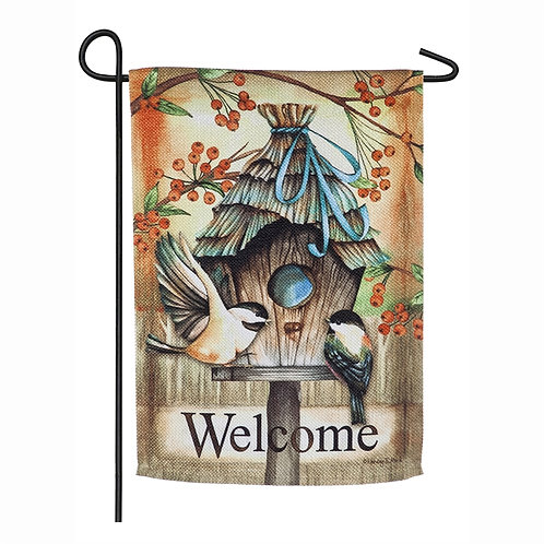 Garden welcome flag of two chickadees perching on a birdhouse.