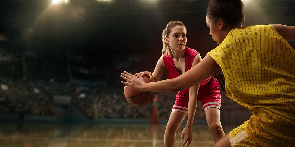Female basketball players fight for the
