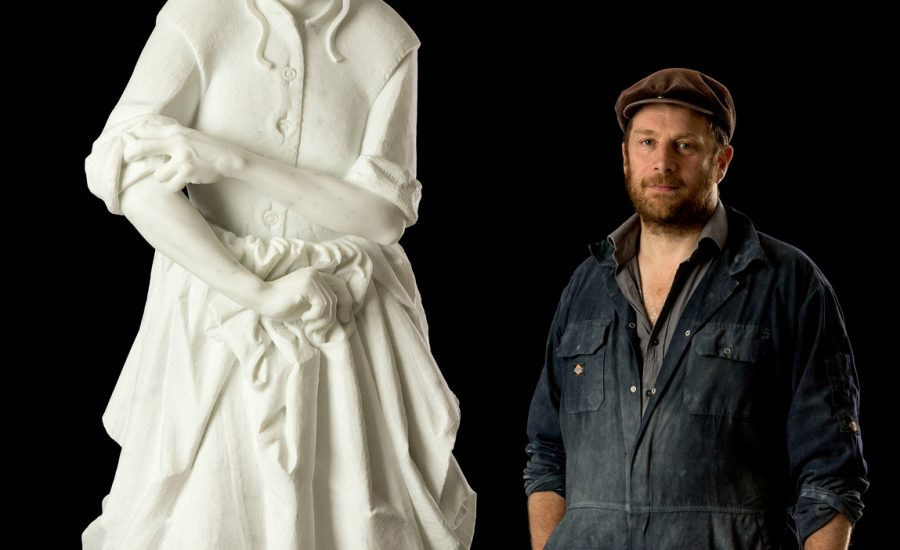 Picture of Simon Smith in front of a white statue