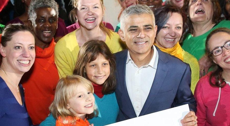 London Mayor Sadiq Khan smiling with a group of people