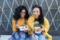 Girls eating Catford Market
