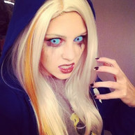 Blonde girl in hoody with blue sclera contacts
