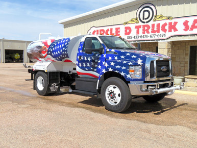 """2020 FORD F750 WITH NEW TIGER 2,000 GALLON WATER TANK, (5) Spray Water Tank System: (2) Front, (2) Rear & (1) Drive Side Spray. Hose Reel, Internal Liner, Push Bumper With Tool Box, In Cab Control Pedestal.  TRUCK: Odo Shows 1,168 Miles, Powerstroke 6.7L Engine, Ford Torqshift 6 Speed Automatic Transmission, 300 HP, Spring Suspension, 33K GVW, 21K RA, 12K FA, 156"""" WB, 84"""" CA/CT, Steel Wheels, 11R22.5 Tires, Deluxe Interior, 50 Gallon Aluminum Fuel Tank, Chrome Bumper, Horizontal Exhaust, Power Door Locks, Power Windows, Tilt/Tele Wheel, Dual High Back Seat, CC, AM/FM, A/C, PWS, Full Factory Engine & Driveline Warranty, Stk# 5952C"""