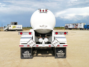 """NEW TIGER DOT 412 TWO COMPARTMENT ACID TRANSPORT, Meets DOT 412 Specifications, 5,000 Gallon, Two Compartment Split (2,000 Gal Front/3,000 Gal Rear). (1) Flying """"M"""" UHMW Manway With Fiberglass Drip Pan, Ridewell Air Ride Suspension, 22,500 Lb. Axles With ABS Anti-Lock System On One Axle, Roll-over Rails At Domes & Vents, Hose Racks Curb Side, Driver Side Walkway & Ladder, Toolbox, Soda Ash Bucket, Spill Kit Assembly With Lab Pack, Sandblast & Internally Coated With Sherwin Williams Dura-Plate 8200, Please Call For Complete Specifications & Options."""