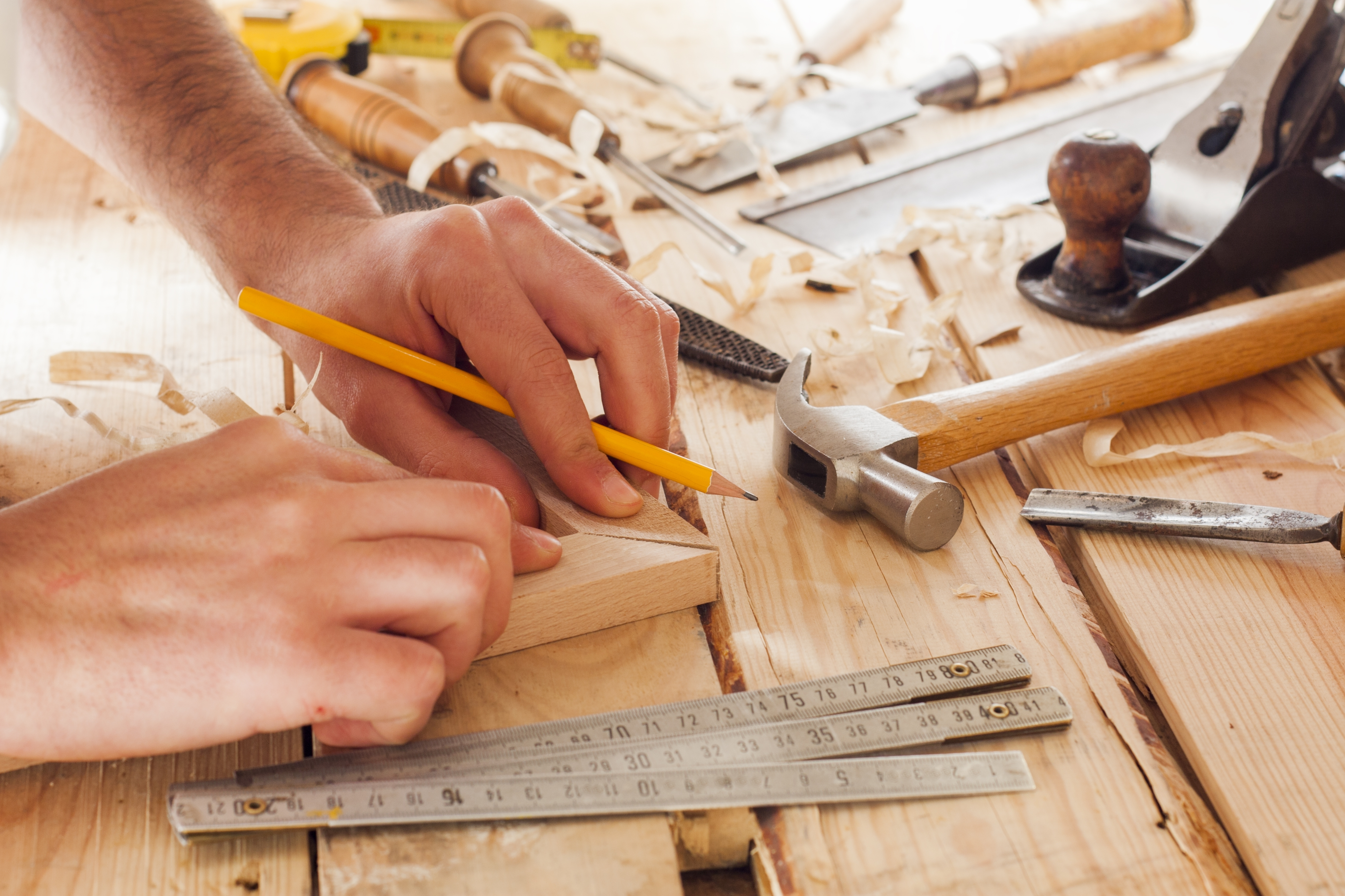 carpenter working,hammer,meter and screw