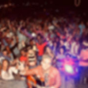 Lead singer of Oscar Soul Experience posing with fans during a live show in Botswana