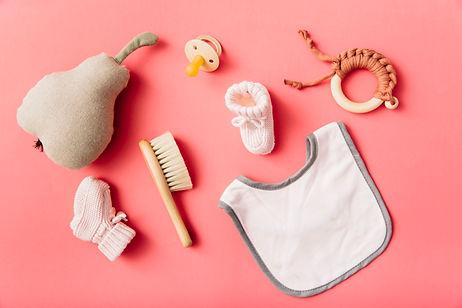 top-view-baby-s-bib-pacifier-sock-brush-