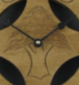 closeup of celtic cross cedar of lebanon clock