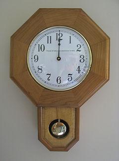 inscribed schoolhouse clock