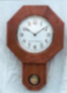inscribed schoolhouse clock
