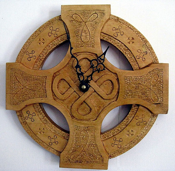 handcarved celtic wall clock