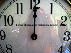 """inscribed schoolhouse clock - """"Forsan et haec olim meminisse iuvabit"""" closeup"""