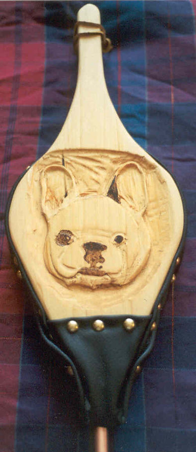 handcarved portrait fireplace bellows