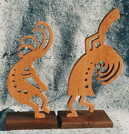 pair of kokopelli jamming