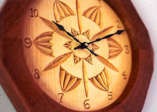 basswood & jatoba chip carved clock closeup