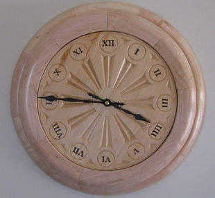 handcarved rose window wall clock