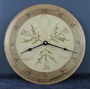 handcarved scottish wall clock
