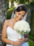 bride in wedding gown holding wedding bouquet