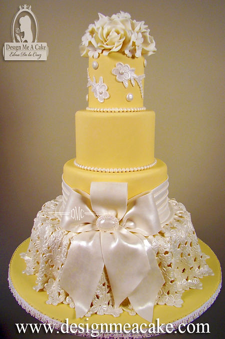 Yellow Cake with lace ad bow
