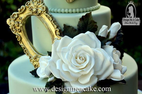 White sugar rose and gold frame