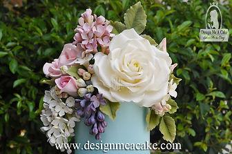 Gold oval frame with rose in gumpaste