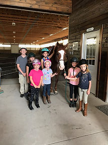 campers getting ready for riding lessons
