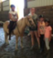 a camper on her favorite pony