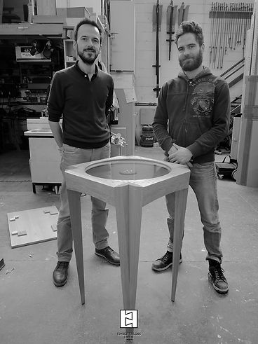 Thibaut Degenne and Thibault Lumpp posing near te St John display cabinet, comissioned b the Defence Medicl Welfare Service, DMWS