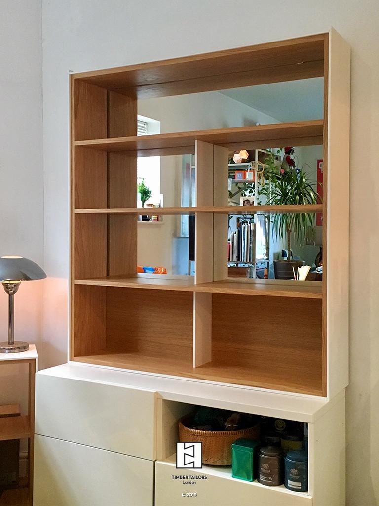Bookshelf with mirrored back