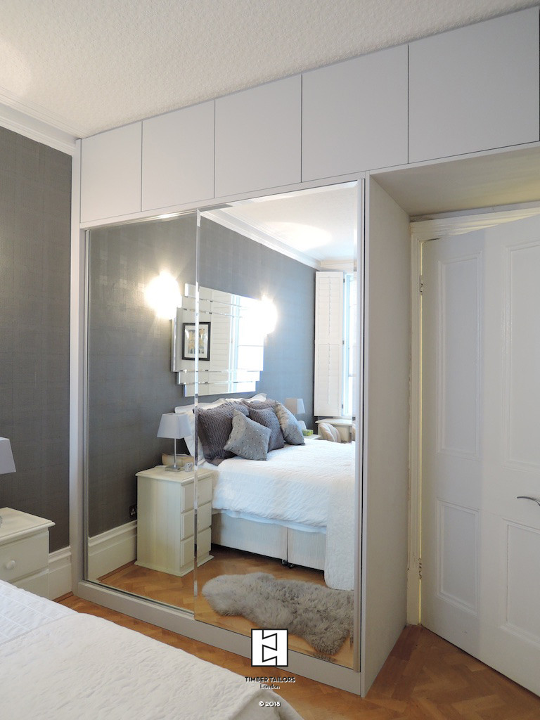 Wardrobe with mirrored sliding doors