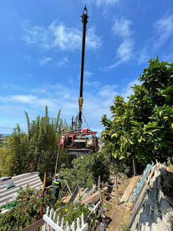 Craning in a drill rig over a steep slope, La Jolla, 2021