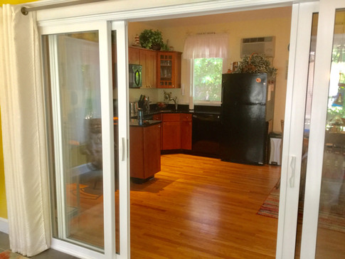 Sliding doors into the kitchen/dining area