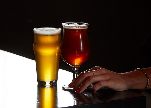 Two spotlit beers in the intimate back bar, The Study