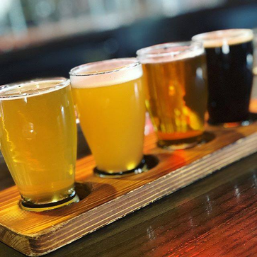 A flight of beers from light to dark