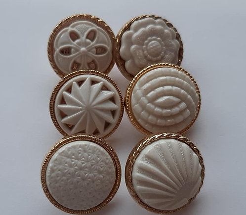 Embossed White and Gold Buttons